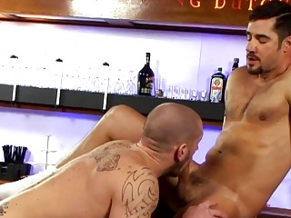 After hours, two gays have anal sex at the bar