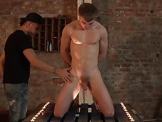 Submissive jock oiled up to have his hard cock stroked