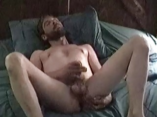 Bearded bear spreads his legs wide so he can jack his wood