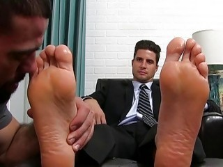 The boss is pleased with his new foot-licking employee