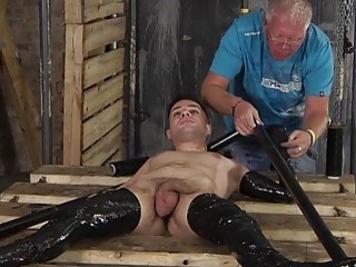 Poor slave is completely wrapped up in plastic