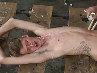 Covered in wax, a twink is rammed hard