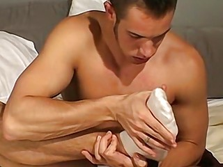 Naughty stud with a foot fetish sucks his toes passionately