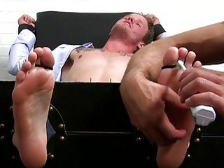 Handsome stud has his bare feet tickled before a handjob