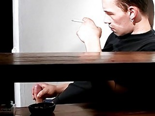 Dashing stud relaxes while smoking and stroking his dick solo