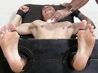 Gay restrained and stripped naked to have his body tickled