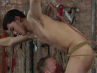 Twink bent over during gay BDSM play and railed rough