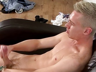 Handsome blond twink strips nude and strokes his huge dick