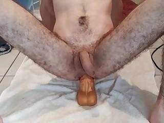 Homo hottie rides a fake horse cock