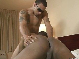 Black homo slut has his legs spread for a deep dicking