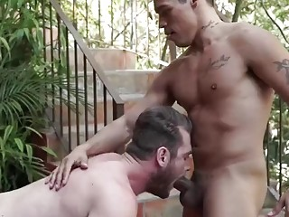 Hardcore gay sex while out on the patio