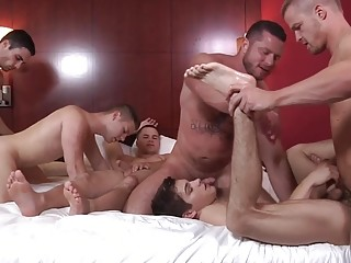 Horny studs breed a couple of hookers during group sex
