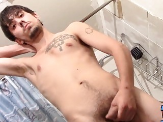 Straight guy Chad Turner masturbates and cums after pissing
