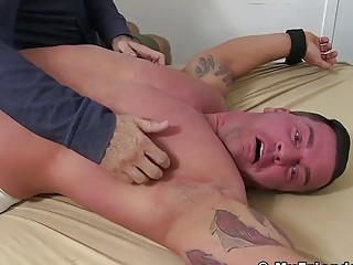 Feet lover tickles a big jock who is tied up and helpless