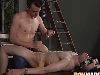 Blindfolded young sub shoots his hot load after a handjob