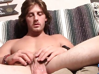 Long haired guy masturbating and smoking